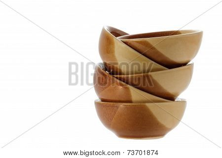 Stack Of Brown Bowls Isolated On White Background.clipping Path.