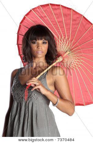 Elegant Brunette Holding Umbrella