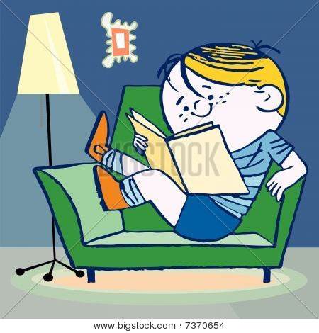 boy sitting on sofa and reading a book.
