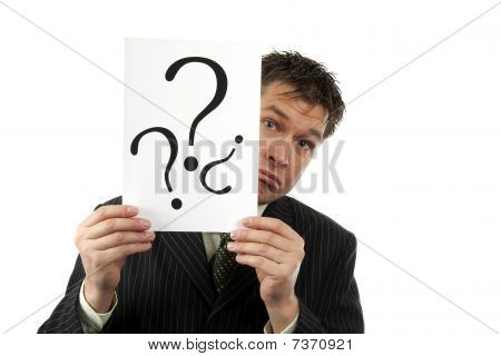 Businessman Is Holding Question Marks