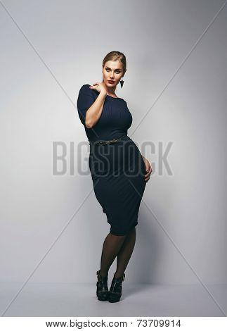 Attractive Curvy Woman In Dark Blue Dress