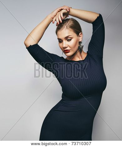Elegant Young Lady Posing On Grey Background