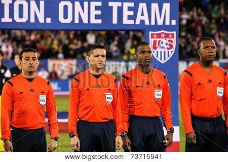 HARTFORD - OCTOBER 10: Referees on Rentschler Field stadium before socce match between US Men`s National Team vs Ecuador, on October 10, 2014, in Rentschler Field stadium, Hartford, USA.