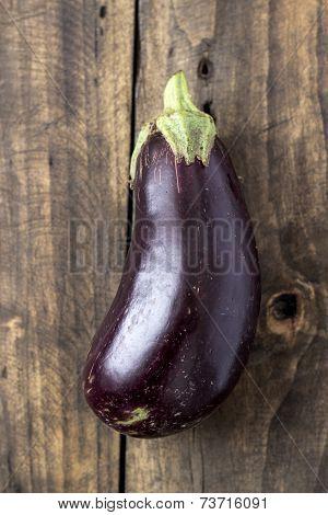 Raw Aubergines Or Eggplants On Wooden Backround.