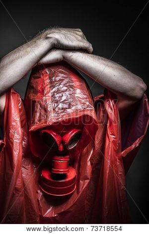Risk, A man in a gas mask over  the smoke. black background and red colors