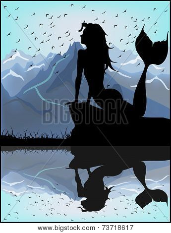 Mermaid Silhouette On A Background Of Blue Mountains