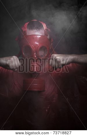 Radioactivity, A man in a gas mask over  the smoke. black background and red colors