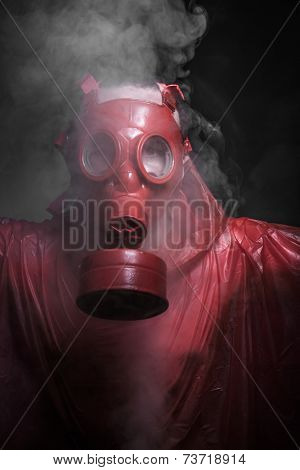 Pollution, nuclear disaster, man with red mask and plastic suit