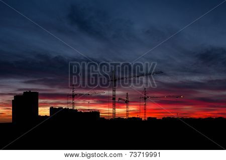 sky at sunset with cityscape panorama