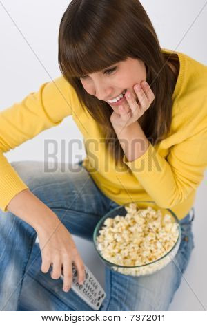 Happy Female Teenager Watching Television