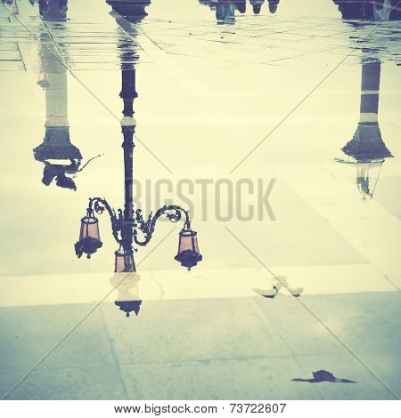 Venice reflects in puddle, Saint Mark's square, Italy. Instagram style filtred image