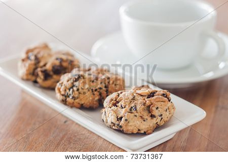 Closeup Cereal Cookies With Coffee Cup