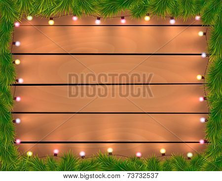 Christmas Lights With Fir Twigs, Wooden Background.