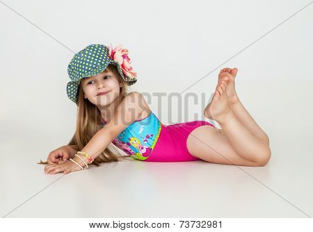 little girls posing in swimsuits and hat