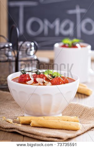 Tomato soup with baked tomatoes and breadsticks