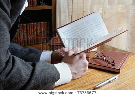 Man Reading A Book With Interest