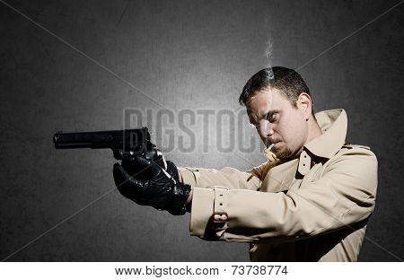Killer Standing On Dark Background Aiming Before Shooting