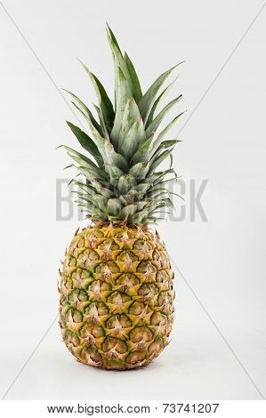 Fresh whole pineapple. Isolated on a white background.