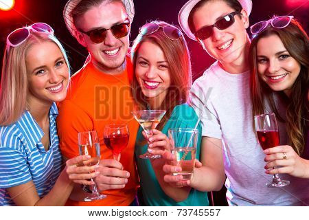 Happy people clinking by glases with each other