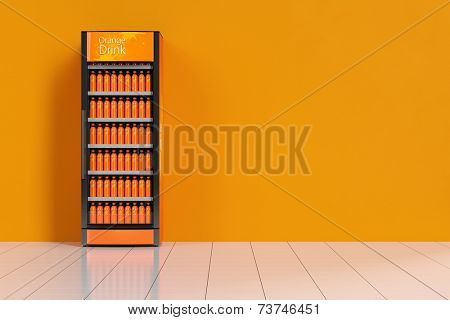 Soda vending machine with orange juice standing in front of a wall