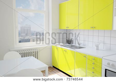 Small yellow kitchen with table in an apartment