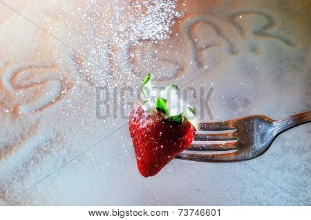 Strawberry On A Fork Punctured And Sugar