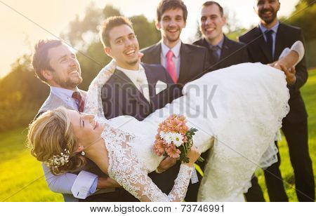 Bride, groom and groomsman