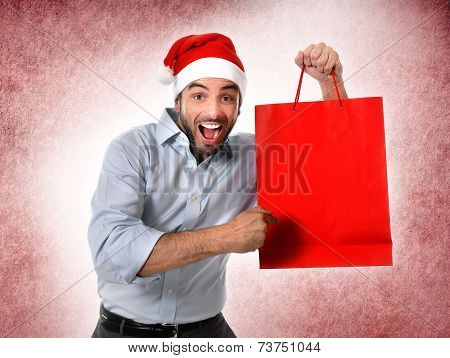 Man Wearing Santa Hat Holding Christmas Shopping Bag Smiling Happy