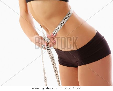 woman measure her waist belly by metre-stick