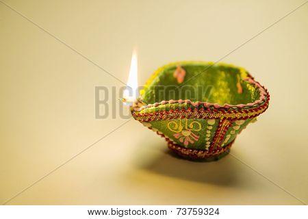 An illuminated, decorative Diwali lamp.