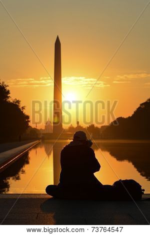 Morning haze and silhouette of photographer in National Mall - Washington DC, United States of America