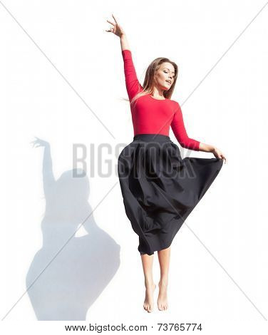 Modern dance concept, woman jumping up