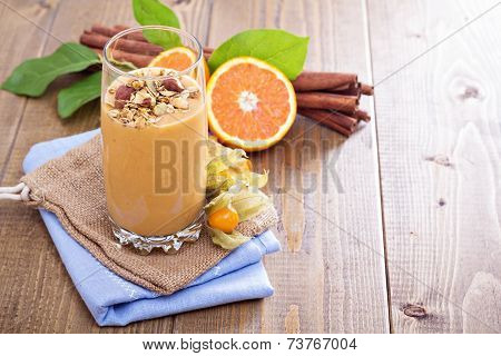 Pumpkin smoothie with granola on top