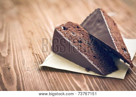 portion of sacher cake on wooden table