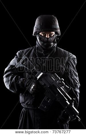 Spec ops soldier on black background