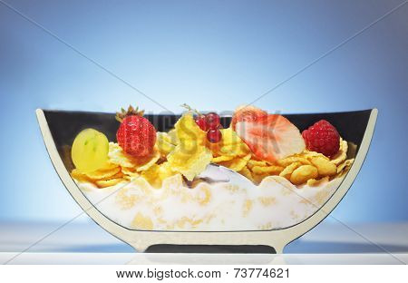 dissected half plate with corn flakes and fruit