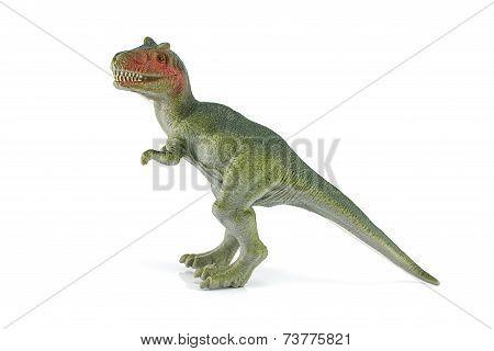 Tyrannosaurus Dinosaur Plastic Figure Toy Model On White Background.