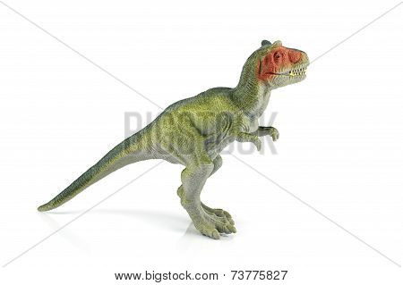 Tyrannosaurus Rex Dinosaur Plastic Figure Toy Model On White Background.