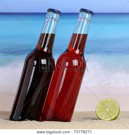 Cola And Lemonade Soft Drinks On The Beach In Sand