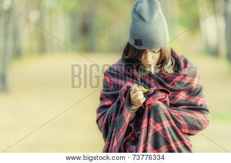 Woman In Wrap With Cigarette And Lighter