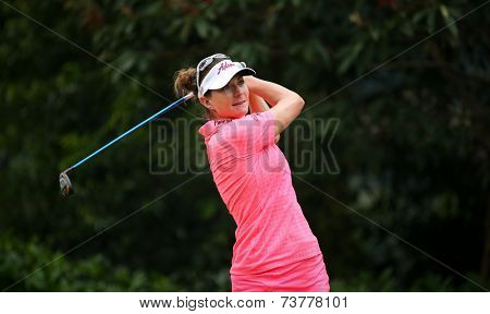 KUALA LUMPUR, MALAYSIA - OCTOBER 11, 2014: Brittany Lang of the USA tees off at the fourth hole of the KL Golf & Country Club during the 2014 Sime Darby LPGA Malaysia golf tournament.