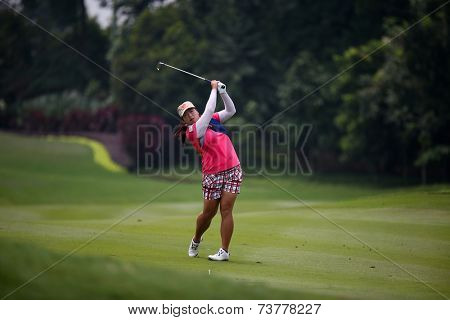 KUALA LUMPUR, MALAYSIA - OCTOBER 11, 2014: Shanshan Feng of China makes a shot from the fairway of the 9th hole of the KL Golf & Country Club during the 2014 Sime Darby LPGA Malaysia golf tournament.
