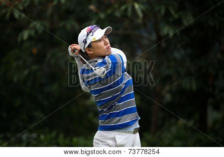 KUALA LUMPUR, MALAYSIA - OCTOBER 11, 2014: Amy Yang of South Korea tees off at the fourth hole of the KL Golf & Country Club during the 2014 Sime Darby LPGA Malaysia golf tournament.