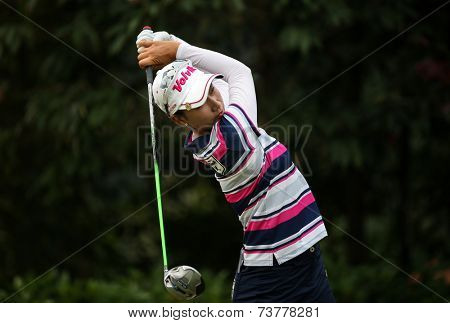 KUALA LUMPUR, MALAYSIA - OCTOBER 11, 2014: Chella Choi of South Korea tees off at the fourth hole of the KL Golf & Country Club during the 2014 Sime Darby LPGA Malaysia golf tournament.