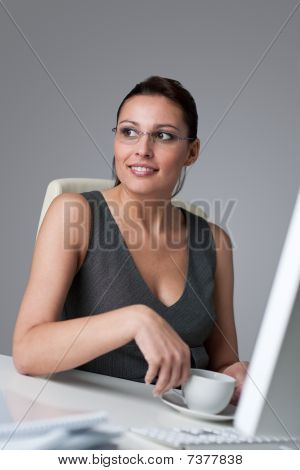 Business Woman Having Coffee Break At Office