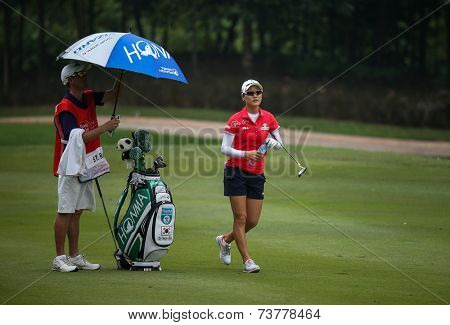 KUALA LUMPUR, MALAYSIA - OCTOBER 10, 2014: So Yeon Rhu of South Korea takes a break at the fairway of the ninth hole of the KL Golf & Country Club at the 2014 Sime Darby LPGA Malaysia golf tournament.