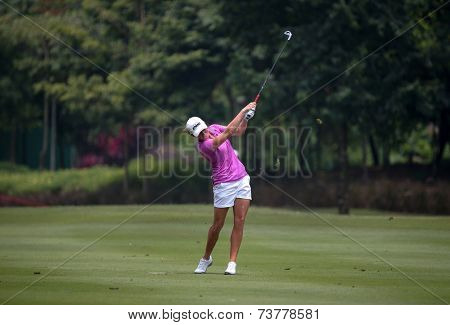 KUALA LUMPUR, MALAYSIA - OCTOBER 10, 2014: Stacy Lewis of the USA plays on the fairway of the ninth hole of the KL Golf & Country Club at the 2014 Sime Darby LPGA Malaysia golf tournament.