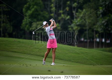 KUALA LUMPUR, MALAYSIA - OCTOBER 11, 2014: Jodie Ewart Shadoff of England makes a shot to the green of the ninth hole of the KLGC Club during the 2014 Sime Darby LPGA Malaysia golf tournament.
