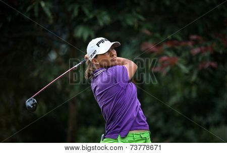 KUALA LUMPUR, MALAYSIA - OCTOBER 11, 2014: Angela Stanford of the USA tees off at the fourth hole of the KL Golf & Country Club during the 2014 Sime Darby LPGA Malaysia golf tournament.