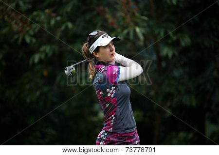 KUALA LUMPUR, MALAYSIA - OCTOBER 11, 2014: Sandra Gal of Germany tees off at the fourth hole of the KL Golf & Country Club during the 2014 Sime Darby LPGA Malaysia golf tournament.